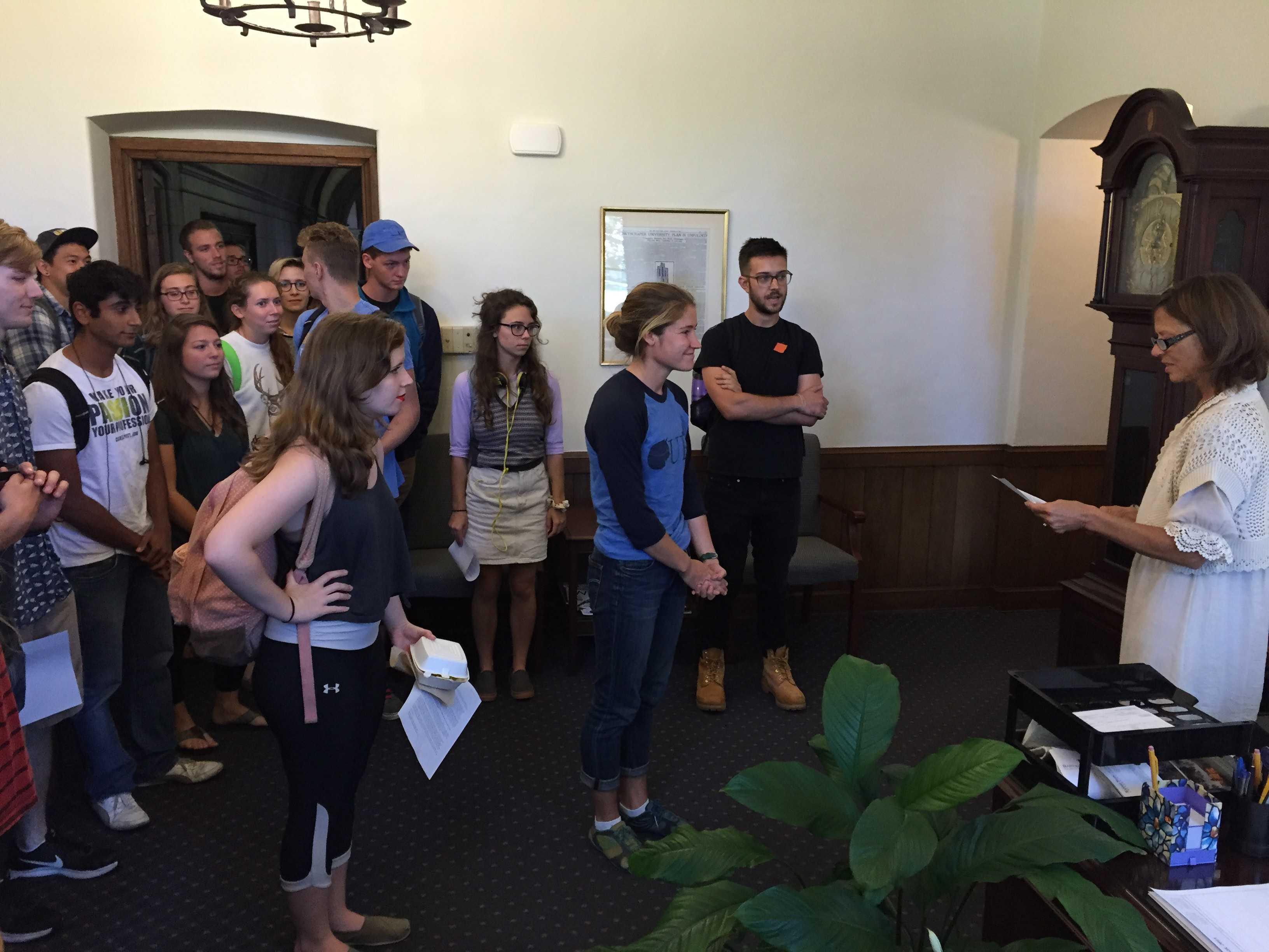 Students hand a letter to Chancellor Gallagher's assistant Sept. 25. Photo courtesy of AID.