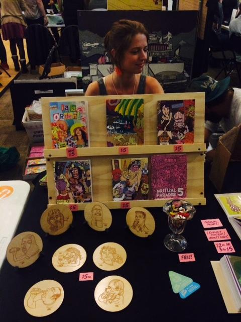 Lizzee Solomon displays her original art at the Zine Festival. Britnee Meiser | Staff Writer