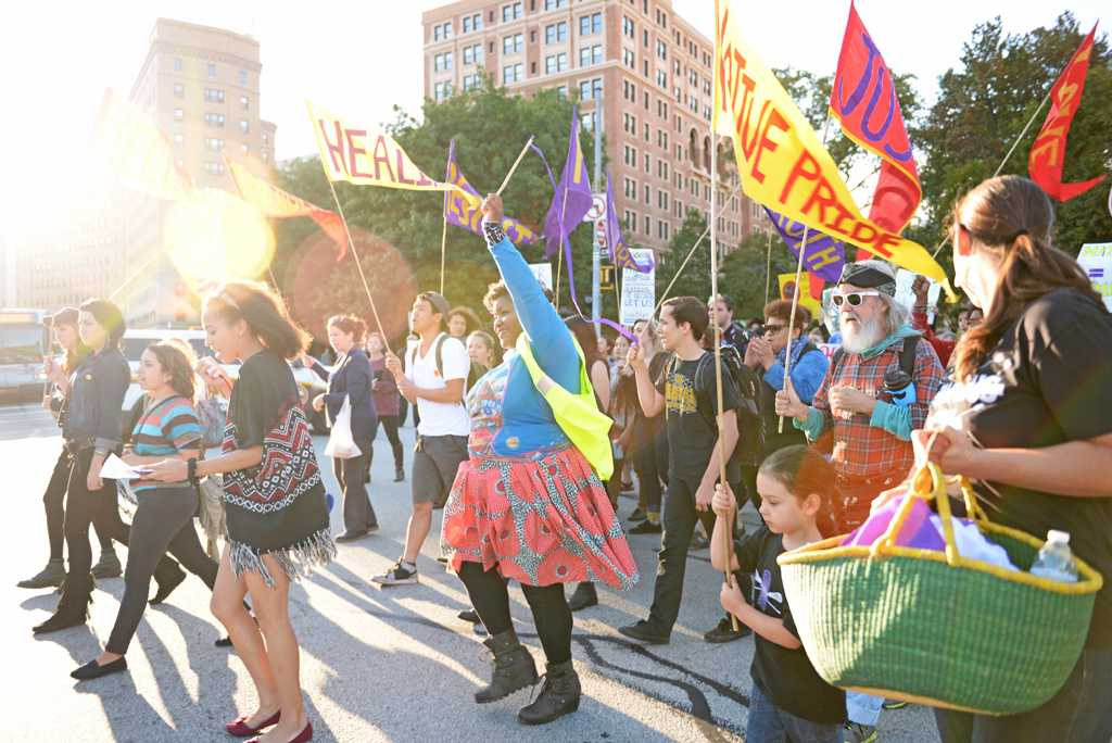 Marchers gather at Bigelow Boulevard to honor Indigenous Peoples Day. | Nikki Moriello / Visual Editor