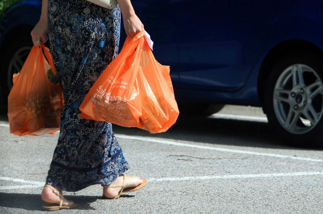 British grocery stores are charging customers to use plastic shopping bags.  Photo by Peter Byrne | Courtesy of the Evening Standard