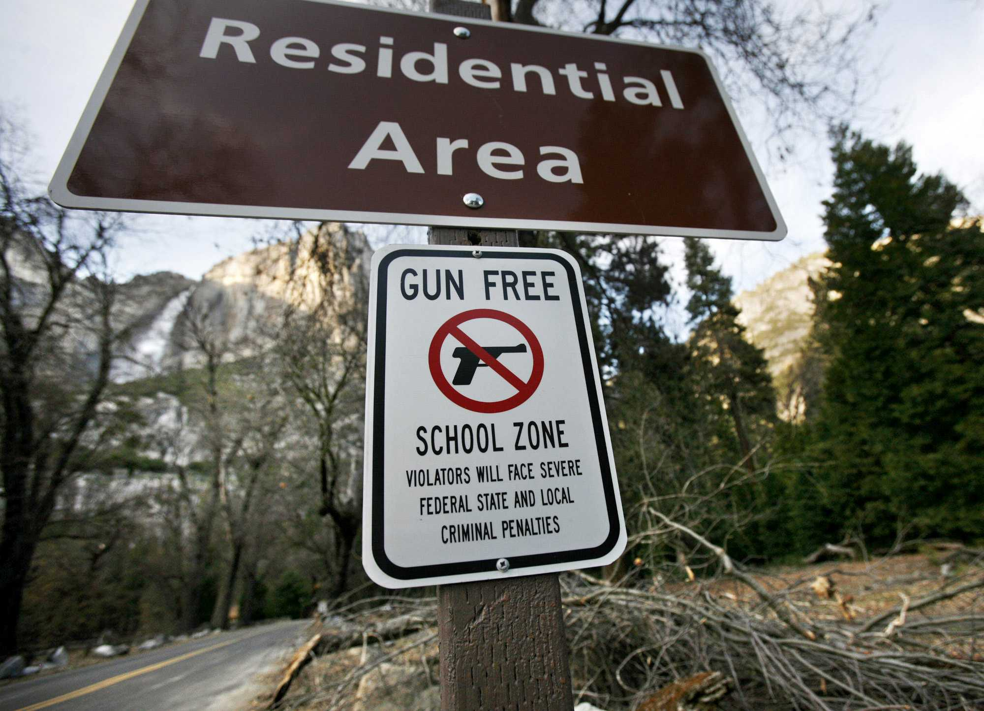 An added sign designating the school in Yosemite Valley a gun-free zone is posted below the residential sign near administrative offices in Yosemite Valley, March 17, 2010. (Eric Paul Zamora/Fresno Bee/MCT)