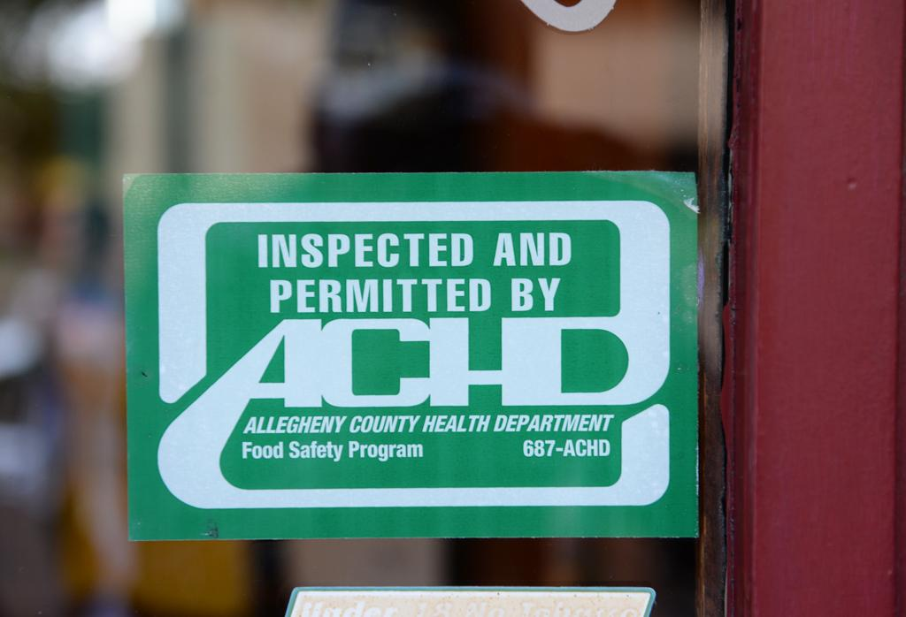 The ACHD rewards restaurants with a green sticker for sufficient health conditions| Photo by Jeff Ahearn
