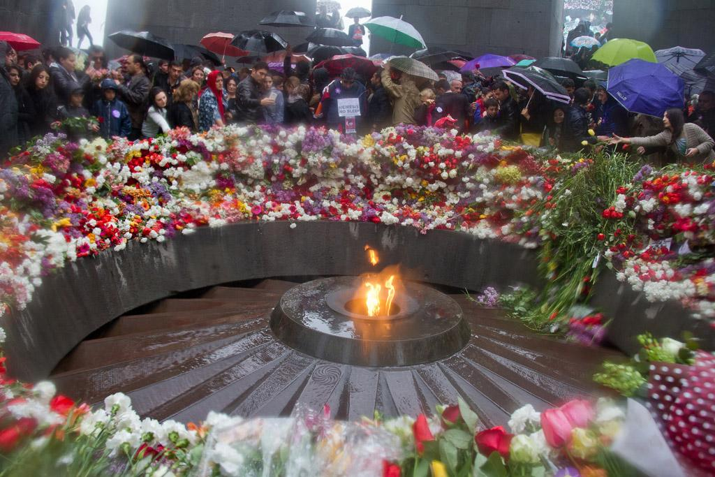 Armenians weather the rain to participate in the Commemoration of the Armenian Genocide on Friday, April 24, 2015, in Yerevan, Armenia. (TNS)