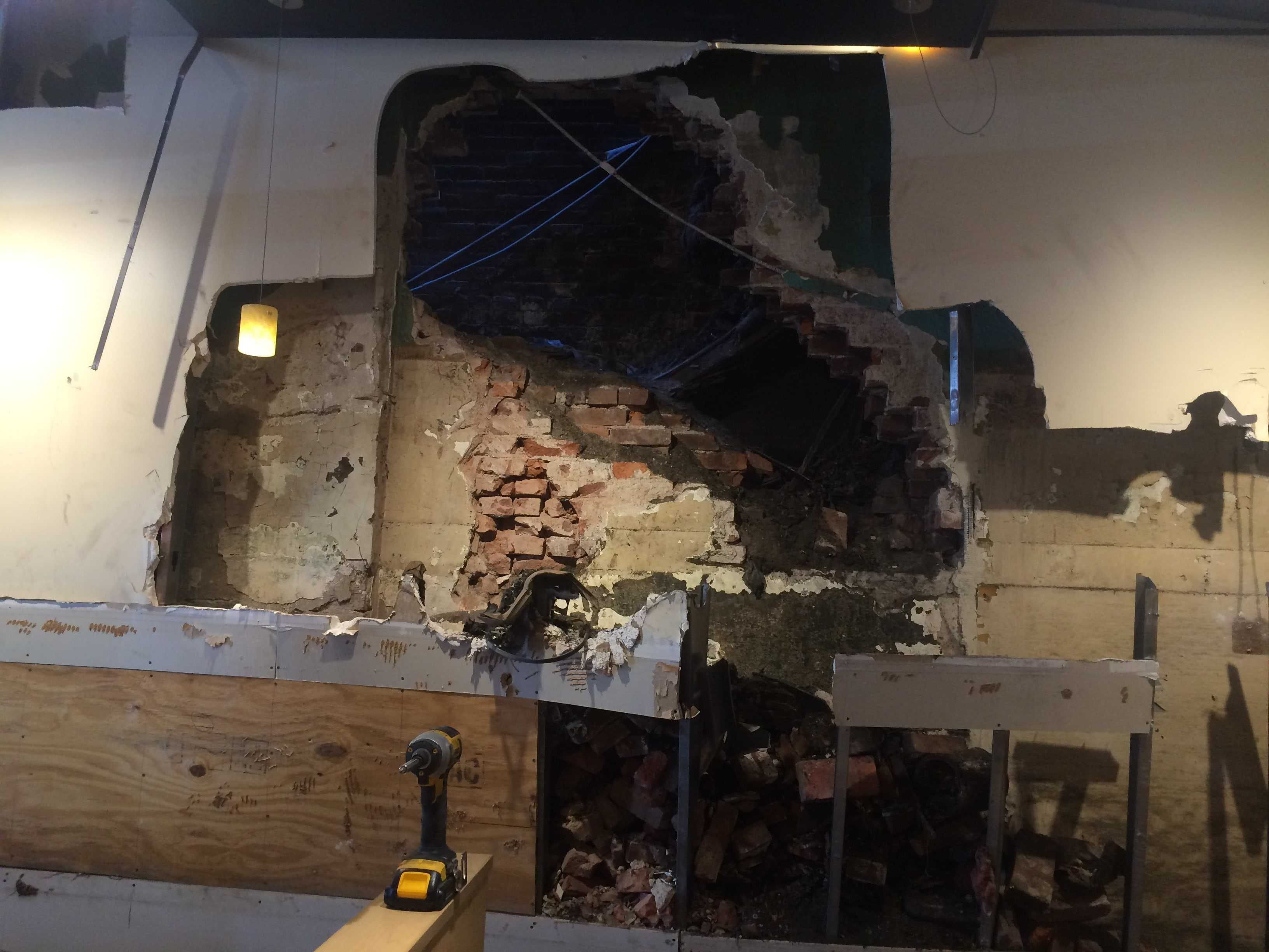Police and fire crews had to drill a large hole in the wall of the Qdoba on Forbes Avenue in Oakland to rescue a Pitt student who was trapped between that wall the adjacent building. Photo: Lauren Rosenbaltt | News Editor