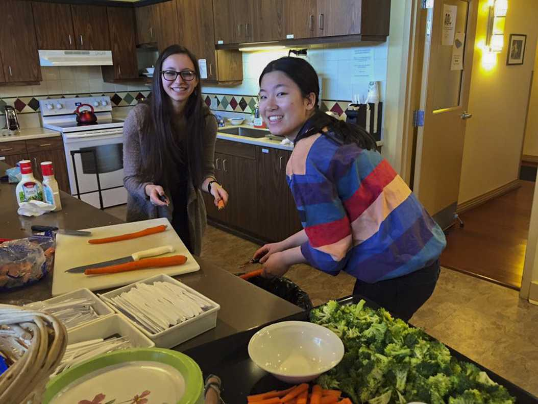 Pitt Food Recovery Heroes members Jessie Cohen (left) and Shutian Shen (right) prepare food at the Ronald McDonald House. | Courtesy of Jessie Cohen.