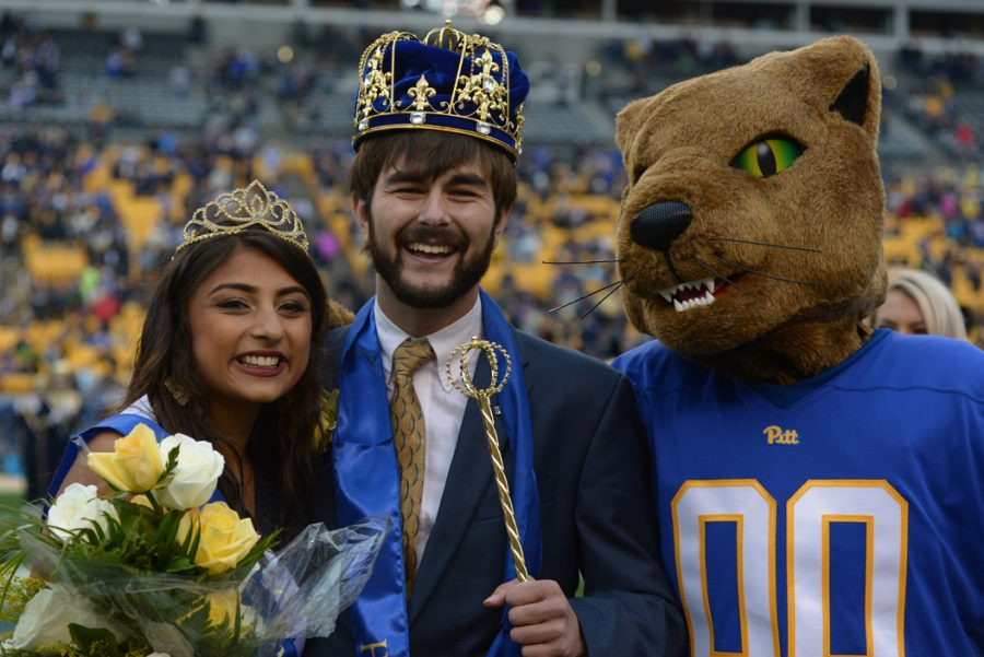 Seniors Seniors Ryan Scandaglia and Aarti Kumar, 2016 homecoming king and queen, pose with Roc the Panther.