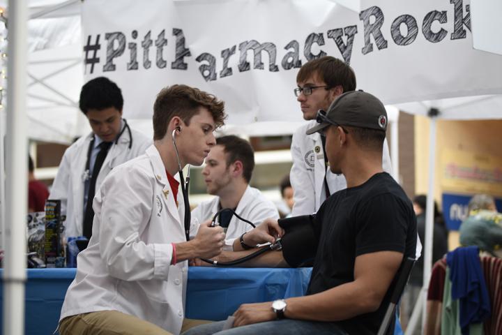 Pitt pharmacy student test festival-goers' blood pressure at Saturday's Rock the Block. | Li Yi, Staff Photographer