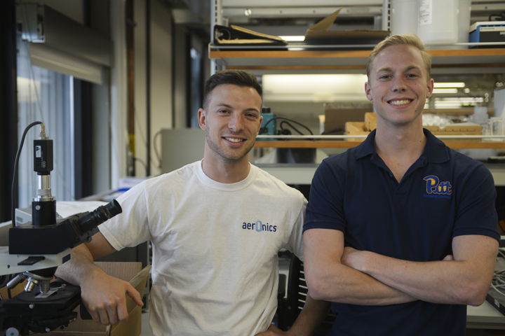 Student innovators Mark Spitz, left, Blake Dube, right, and Alec Kaija (not pictured) developed a portable oxygen device that has won them local and national honors | John Hamilton, Senior Staff Photographer