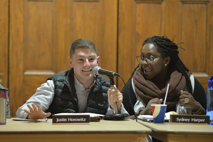 Board members Justin Horowitz and Sydney Harper expressively discuss allocations at Tuesday's meeting | Will Miller, Senior Staff Photographer