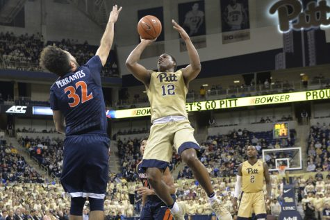 Panthers guard Chris Jones shoots over Virginia guard London Perrantes in the first half of Pitt's 88-76 win. Elaina Zachos | Senior Staff Photographer