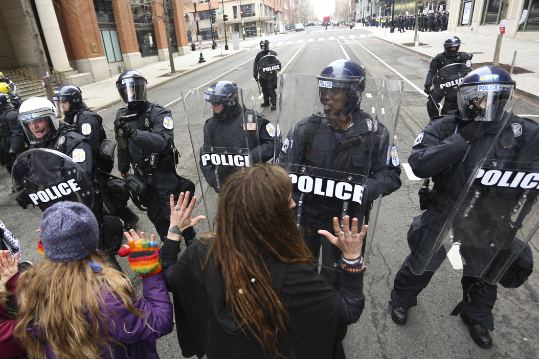 Police push back protesters on 12th Avenue during street protests following the inauguration of President Donald Trump.  Among the 230 people arrested during the Inauguration protests, five of them were Pitt students. John Hamilton | Visual Editor