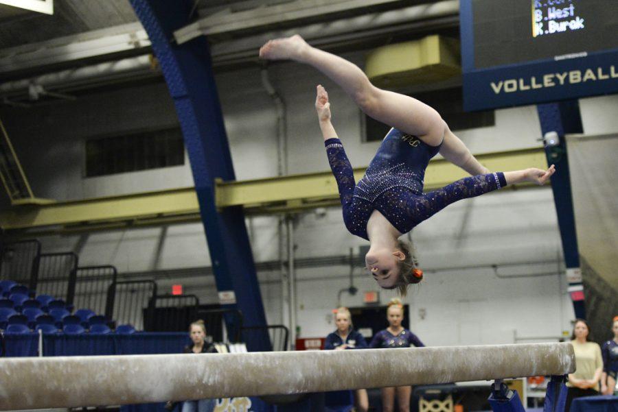 Lucy Jones flips during her beam routine. Jeff Ahearn|Senior Staff Photographer