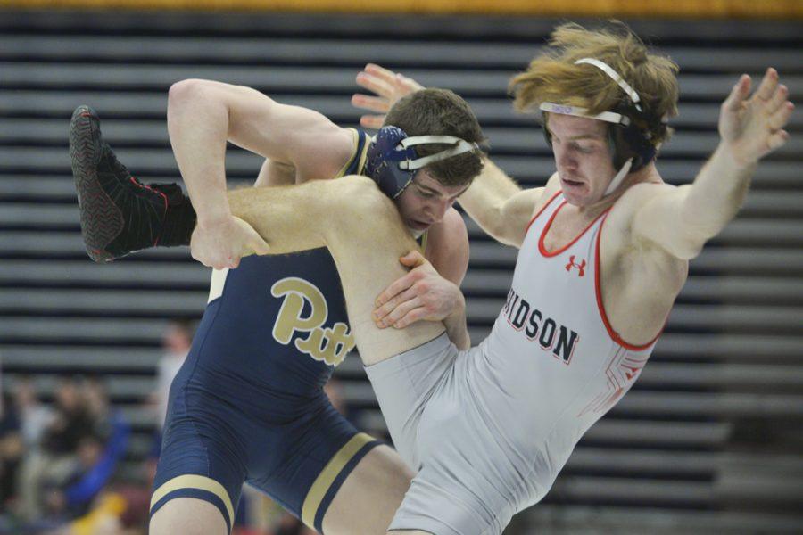 Pitt junior Dom Forys wrestles Davidson's Dustin Runzo. Forys won in a technical fall. John Hamilton|Visual Editor