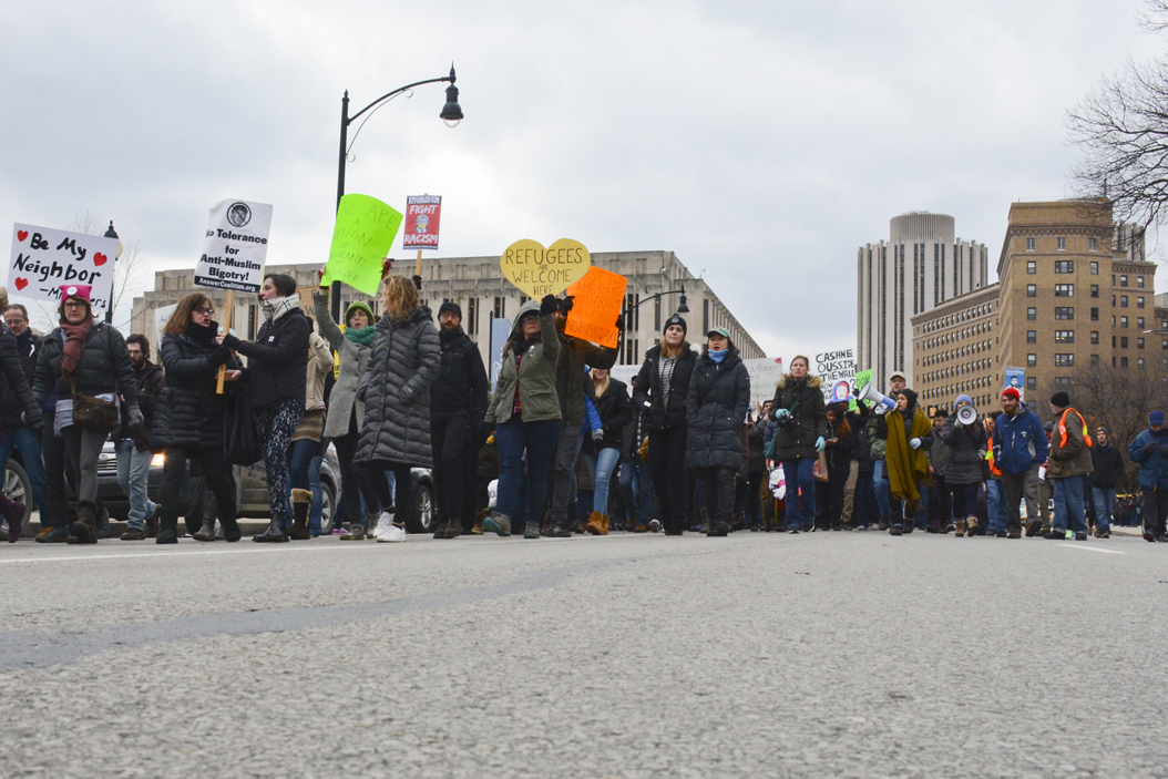 Protesters march down Forbes Avenue on Saturday at rally organized to protest Trump's executive order on immigration. Stephen Caruso | Online Visual Editor