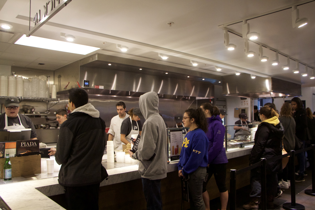 Customers wait in line at the grand opening of Piada Italian Street Food. Donny Falk | Staff Photographer