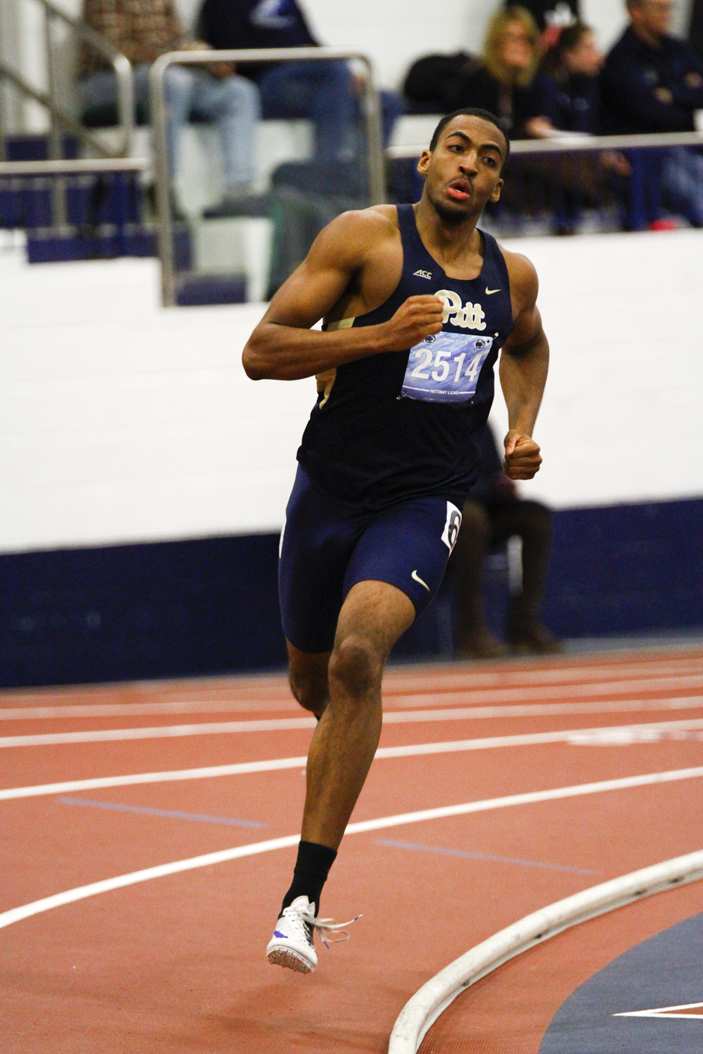 Pitt senior Desmond Palmer rounds the track during his record-setting 600-meter victory Saturday at the Nittany Lion Challenge. Courtesy of Barry Schenk / Pitt Athletics