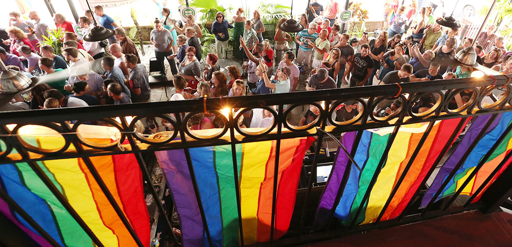 Hundreds of supporters gather during a party at the Hammered Lamb bar in Orlando, Fla., to celebrate the U.S. Supreme Court ruling allowing gay marriage nationwide on Friday, June 26, 2015. (Stephen M. Dowell/Orlando Sentinel/TNS)
