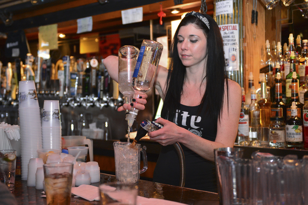 Katie Keenan pours a Long Island Iced Tea on a Thursday night at Hemingway's Cafe. Meghan Sunners | Assistant Visual Editor