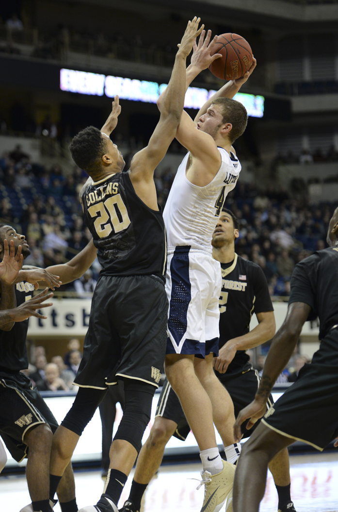 John Collins tries to block Ryan Luther during a game last February. John Hamilton | Visual Editor