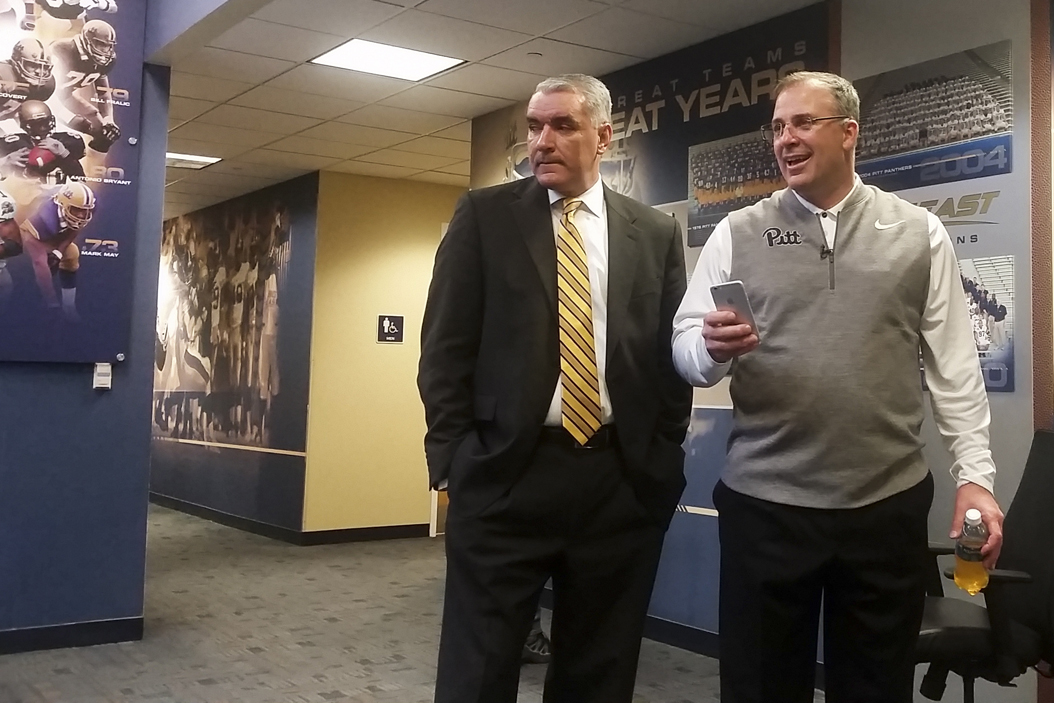 Pitt head coach Pat Narduzzi and Julio Freire, Pitt's deputy athletic director for external affairs, take a moment during National Signing Day to converse with reporters. Steve Rotstein | Contributing Editor