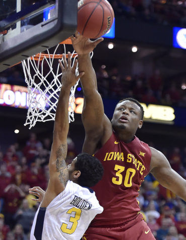 Iowa State's Deonte Burton, right, swats a shot by West Virginia's James Bolden out of the air during the second half in the Big 12 Tournament final at Sprint Center in Kansas City, Missouri, on Saturday, March 11, 2017. Iowa State won, 80-74. (Rich Sugg/Kansas City Star/TNS)