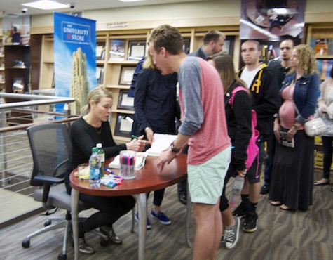 Chelsea Handler autographs books at University Store