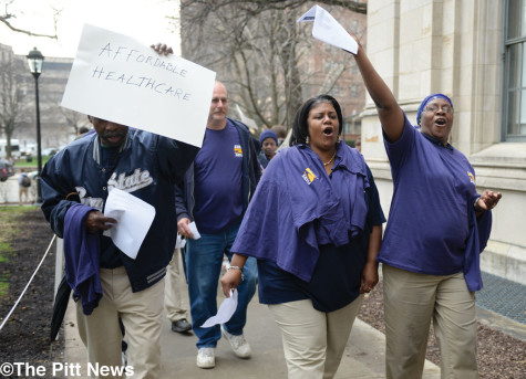 Service workers rally outside the Cathedral of Learning