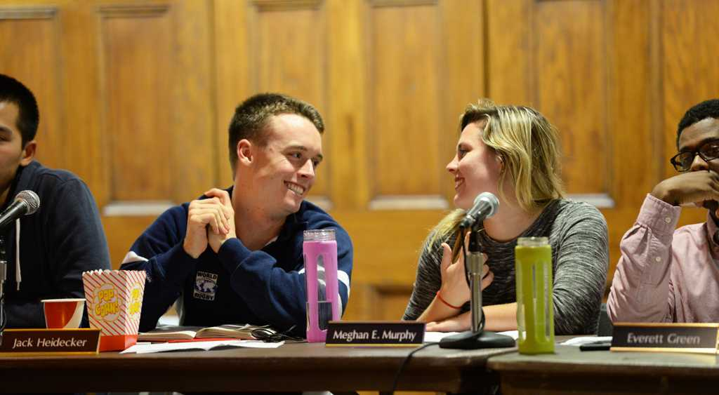Student Government Board members Jack Heidecker and Meghan Murphy converse during Tuesday's meeting. Abigail Self | Staff Photographer