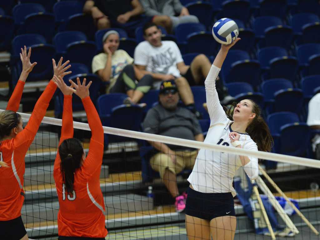 Kadi Kullerkann goes up to spike a ball.  Jeff Ahearn | Assistant Visual Editor