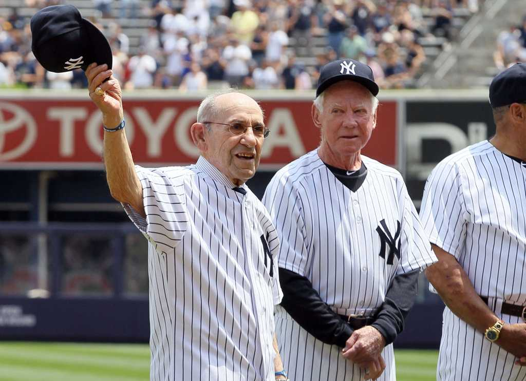 Yogi Berra, left, and Whitey Ford are seen during the New York Yankees 65th Old Timers Day ceremony. The New York Yankees defeated the Colorado Rockies, 6-4, at Yankee Stadium in New York on Sunday, June 26, 2011.