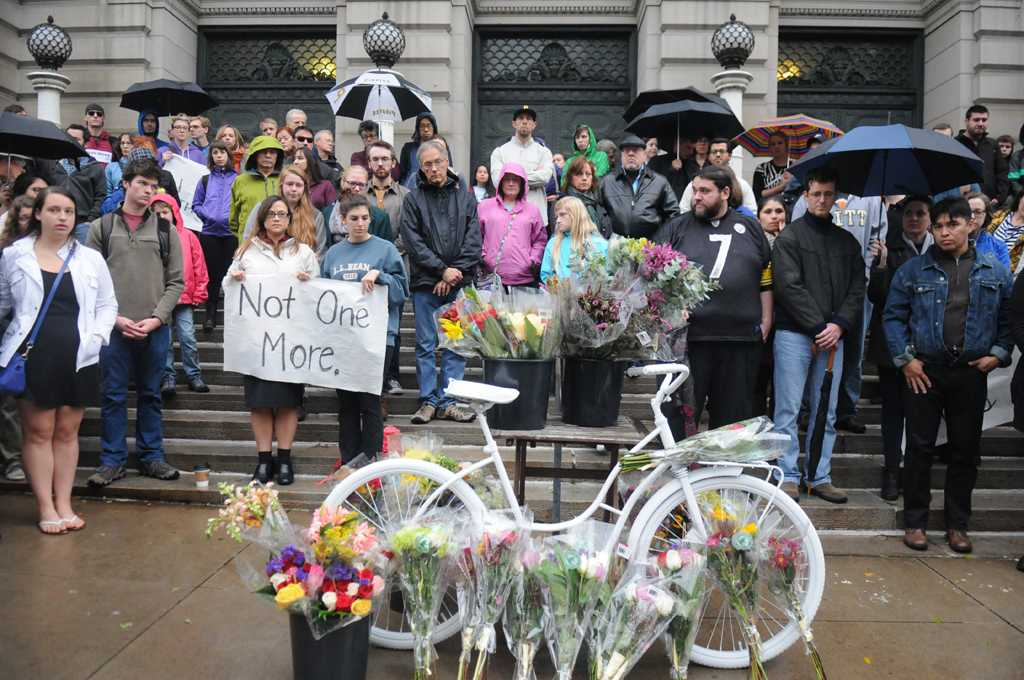 A crowd gathers outside Carnegie Music Hall to honor Susan Hicks, who lost her life in a cycling accident on Friday.  Wenhao Wu | Staff Photographer