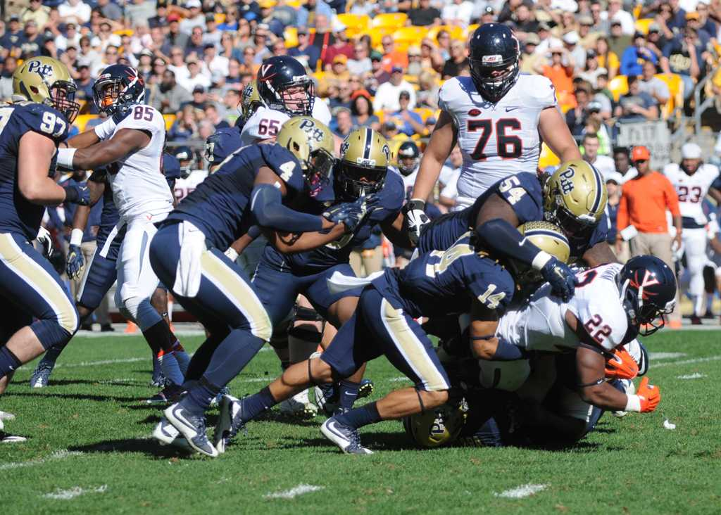 Pitt defense takes down Virginia touchback Daniel Hamm on Saturday.  Emily Klenk | Staff Photographer