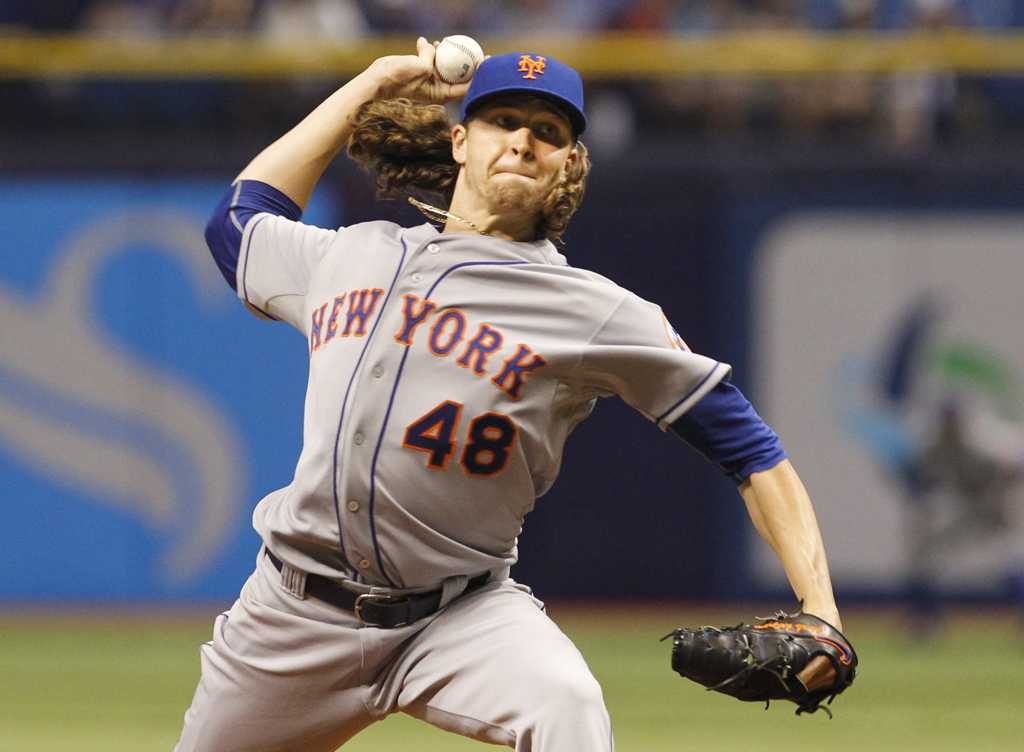 New York Mets starting pitcher Jacob deGrom throws in the first inning against the Tampa Bay Rays at Tropicana Field in St. Petersburg, Fla., on Friday, Aug. 7, 2015. (Will Vragovic/Tampa Bay Times/TNS)