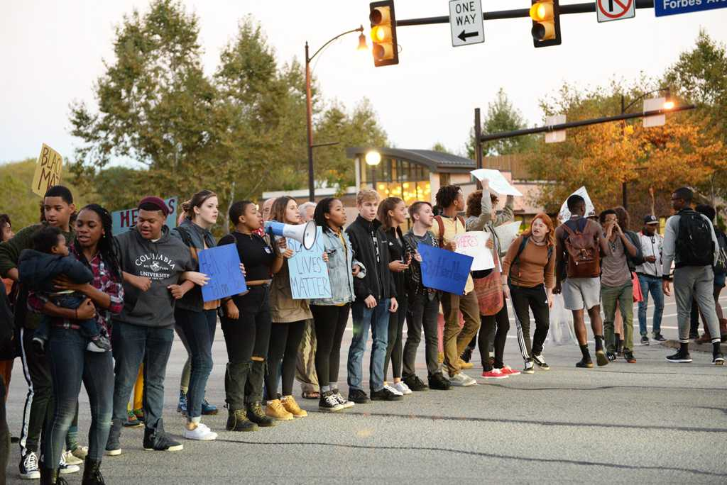 Protesters stop traffic on Forbes and Bigelow. | Jeffrey Ahearn / Assistant Visual Editor