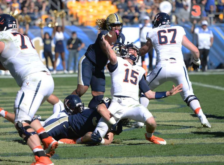 Virginia quarterback Matt Johns struggles to get a pass out thanks to Pitt's defense. Jeff Ahearn | Assistant Visual Editor