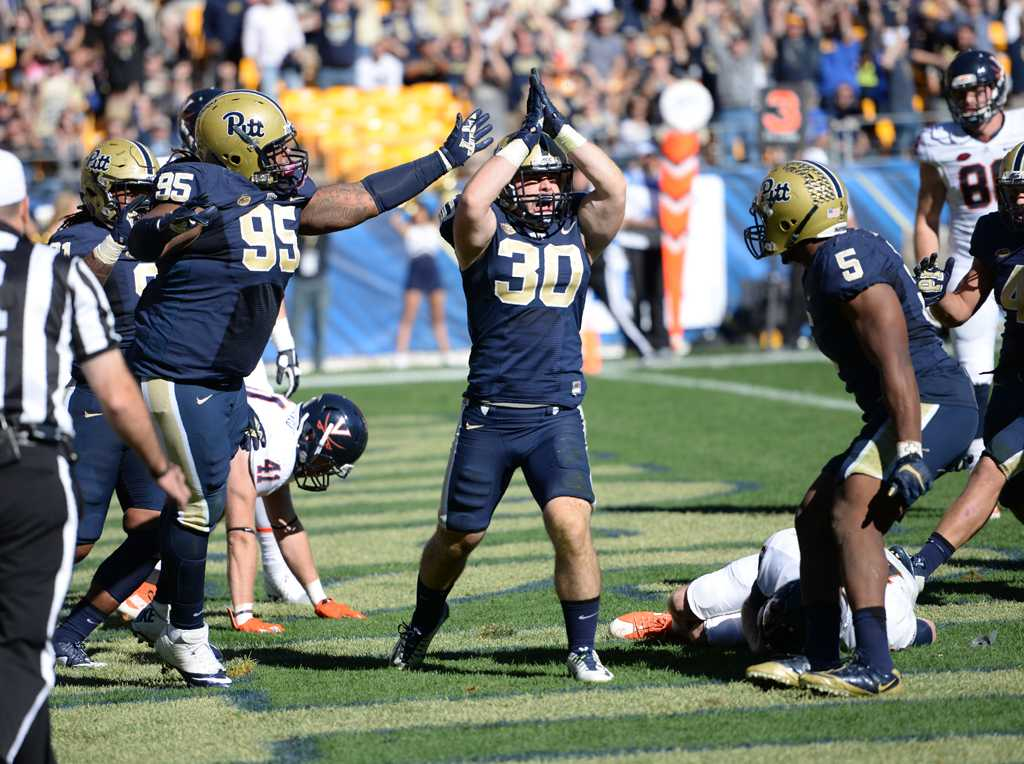 Linebacker Mike Caprara celebrates a safety against Virginia.  Jeff Ahearn | Senior Staff Photographer