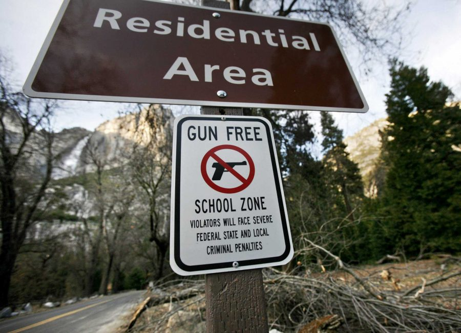 An+added+sign+designating+the+school+in+Yosemite+Valley+a+gun-free+zone+is+posted+below+the+residential+sign+near+administrative+offices+in+Yosemite+Valley%2C+March+17%2C+2010.+%28Eric+Paul+Zamora%2FFresno+Bee%2FMCT%29