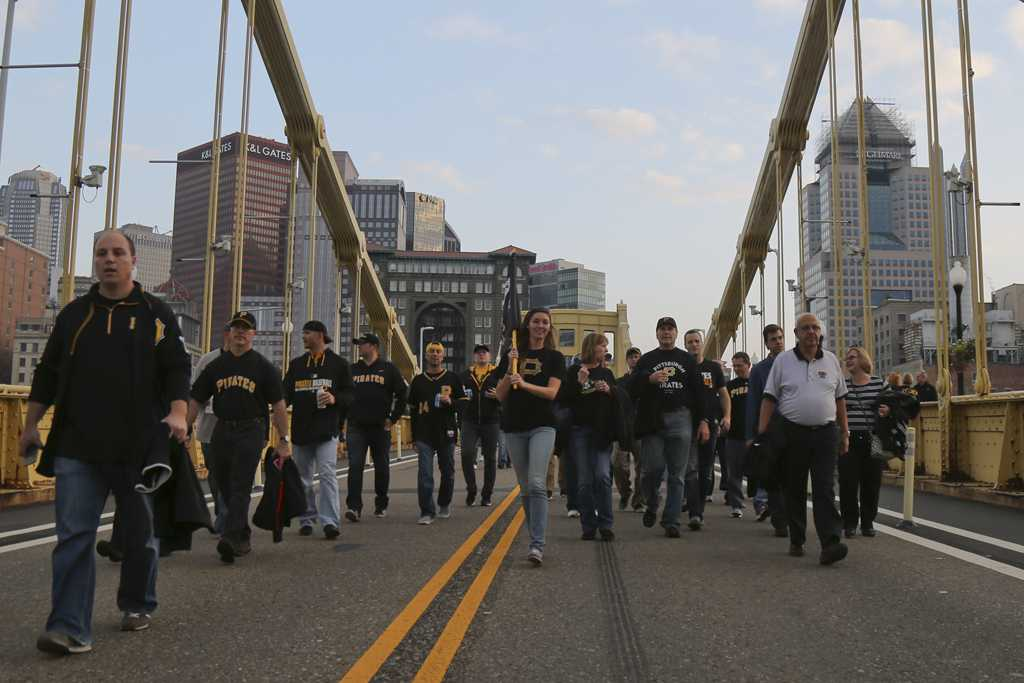 Hoards of Pirates Fans crossed the Roberto Clemente Bridge to get to PNC Park.  Theo Schwarz | Senior Staff Photographer