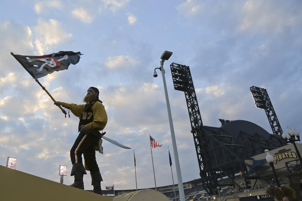 Bucco Louie waves the Jolly Roger. | Theo Schwarz | Senior Staff Photographer