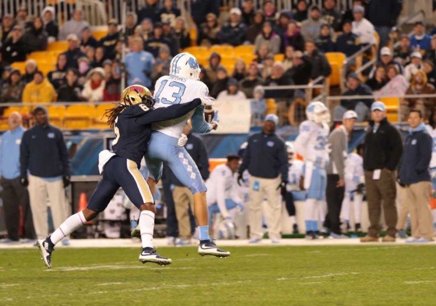 Lafayette Pitts takes down Tar Heels' wide receiver, Mack Hollins on Thursday's game.  Nikki Moriello | Visual Editor