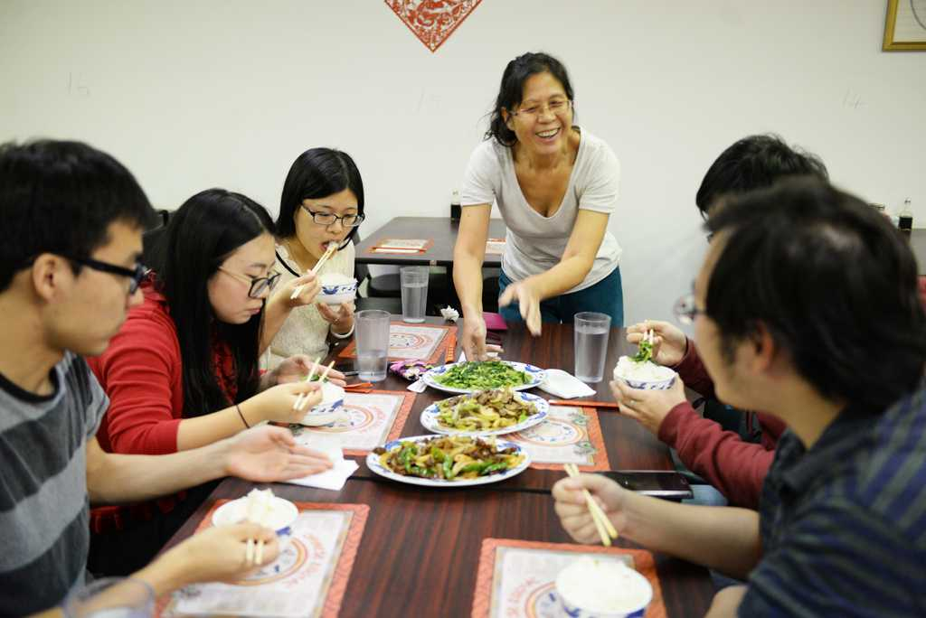 "Students indulge in Chinese dinner at Tong's Cuisine, where Zhi Feng serves ""authentic"" and ""simple"" home-style cooking. Meghan Sunners 