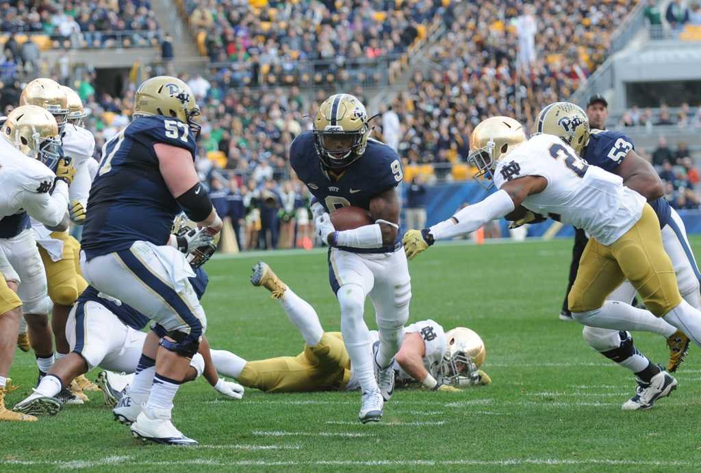 Jordan Whitehead runs in the first of his two touchdown on Saturday.  Heather Tennant | Staff Photographer
