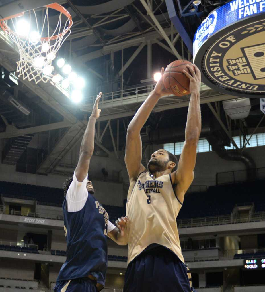 Alonzo-Nelson Ododa goes up for the shot.  Wenhao Wu | Staff Photographer