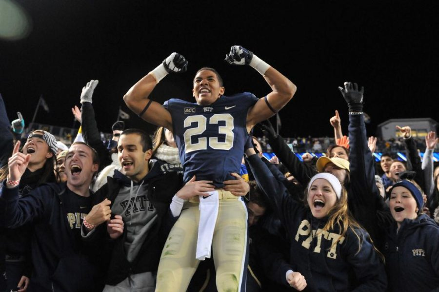 Tyler+Boyd+celebrates+with+Pitt+students+after+defeating+Notre+Dame+in+2013.++TPN+File+Photo