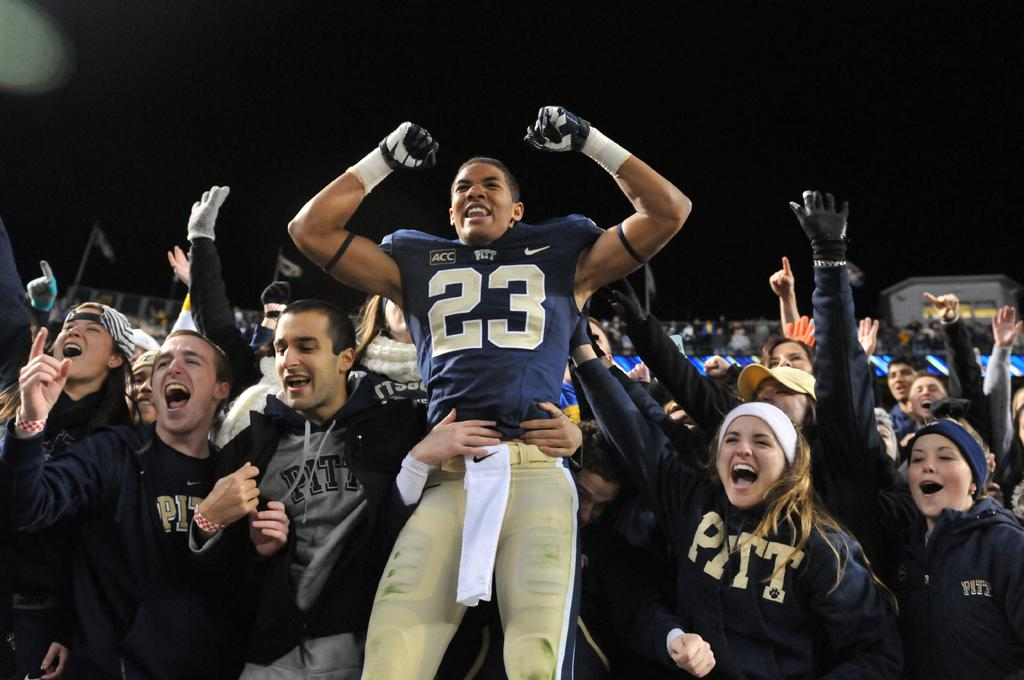Tyler Boyd celebrates with Pitt students after defeating Notre Dame in 2013.  TPN File Photo