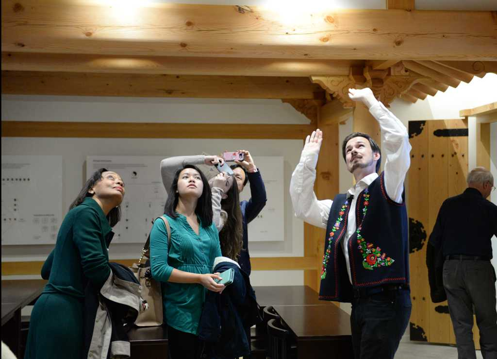 Visitors get their first look at the intricate woodwork inside the Korean Nationality  Room during its grand opening Saturday afternoon on the third floor of the Cathedral of Learning.  Jeff Ahearn | Assistant Visual Editor