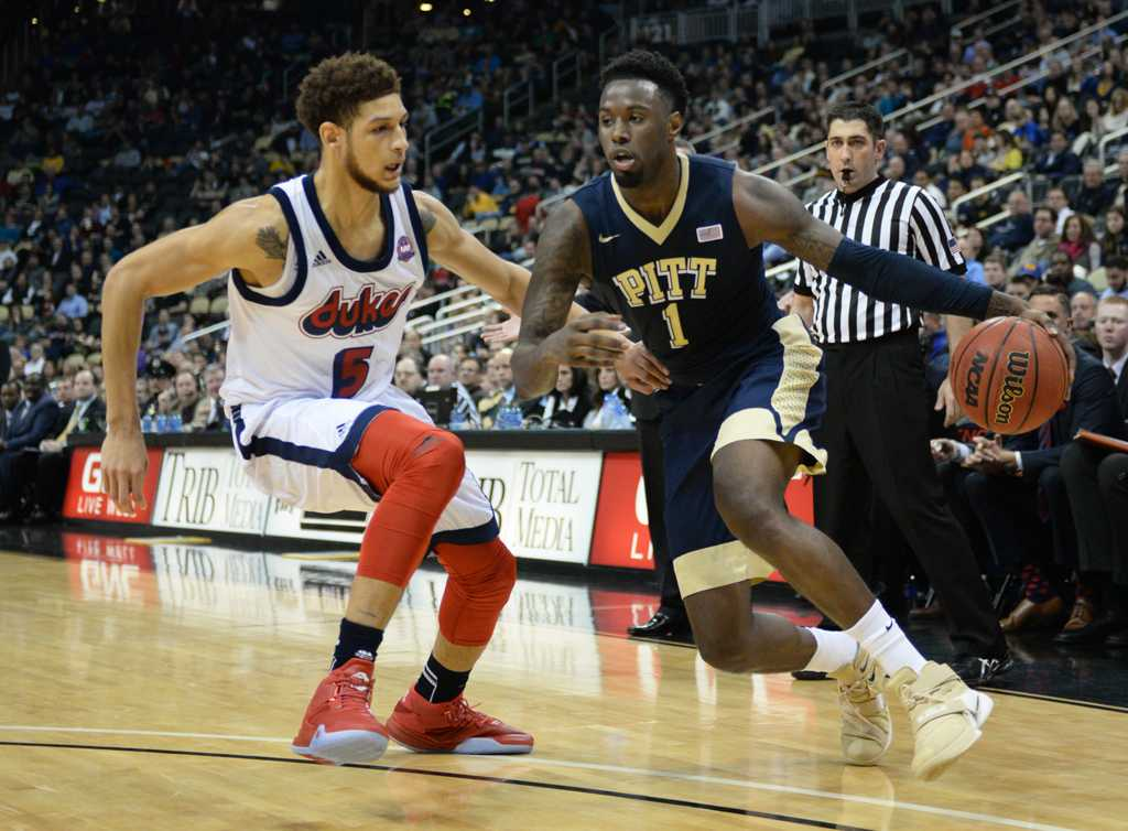 Jamel Artis battles his Duquesne blocker, TySean Powell.  Wenhao Wu | Staff Photographer