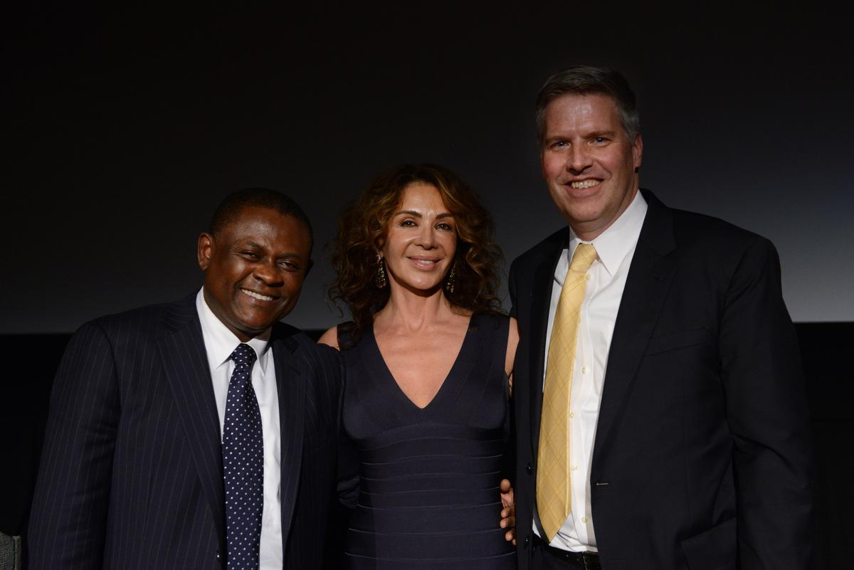 Dr. Bennet Omalu (left), Giannina Scott (center), President and CEO of the Bennet Omalu Foundation, and University of Pittsburgh Chancellor Patrick Gallagher pose for a photo after Scott and Gallagher signed a memorandum of understanding between the two organizations where the University will provide support with research around Chronic Traumatic Encephalopathy (CTE) and Traumatic Brain Injuries (TBI) during a screening of Sony Pictures