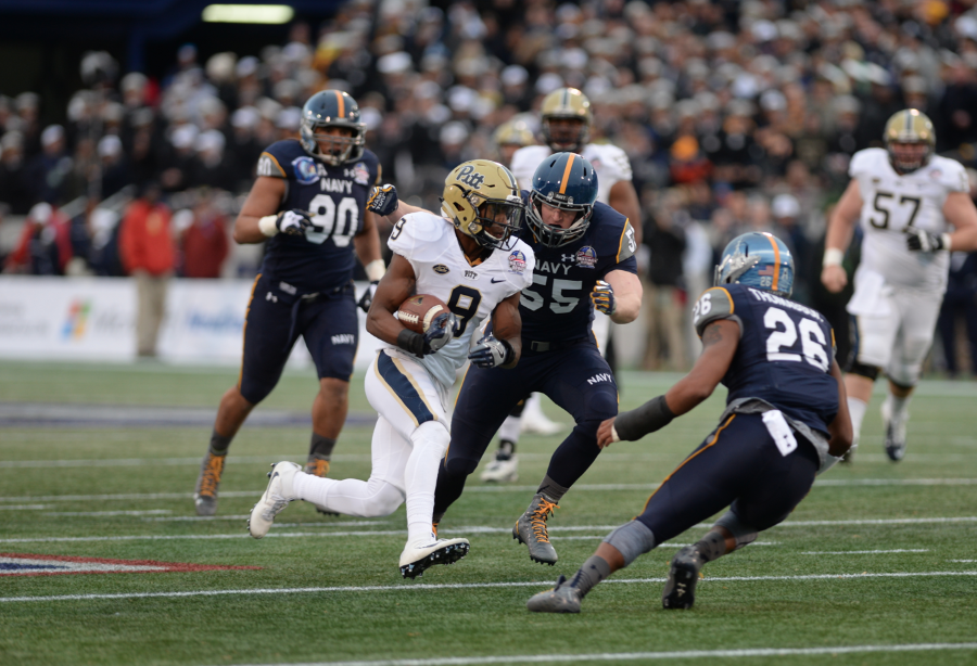 Freshman Jordan Whitehead avoids two Navy defenders.  Nikki Moriello | Visual Editor