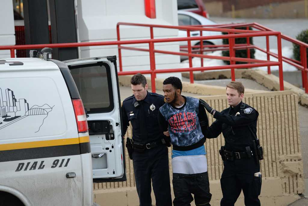 A suspect is taken into custody by the Pittsburgh Police at the Arbys on Forbes Avenue.  Jeff Ahearn | Assistant Visual Editor